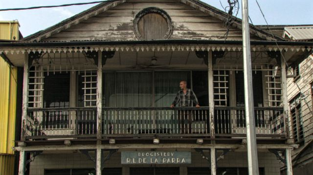 Figure 1. Pim de la Parra on the upper veranda of his childhood home in Paramaribo, Suriname. He lived here from age seven to twenty with his father, brother and five aunties. De la Parra used to have his bedroom on the first floor whilst the ground floor functioned as his father's pharmacy. 'My father was very busy earning money to maintain our household. He ran a pharmacy and was a wholesaler of medicines.' Photo by: In-Soo Productions / Fu Works.